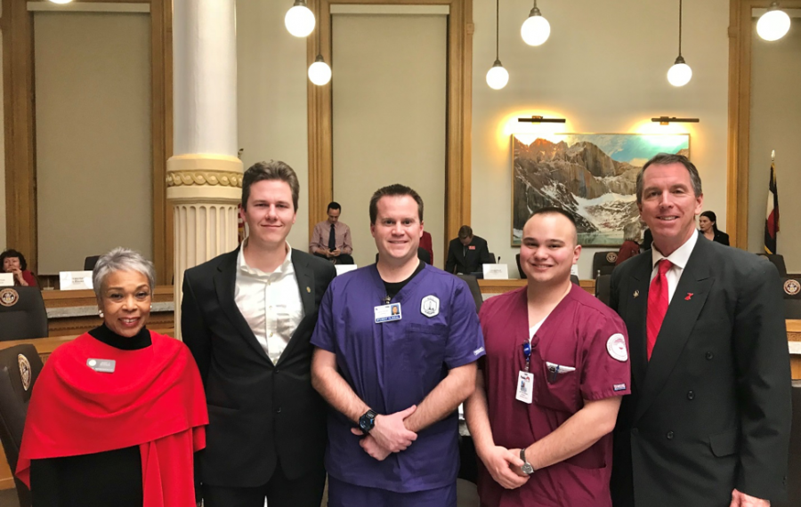 nursing students pose for photo as bill passes