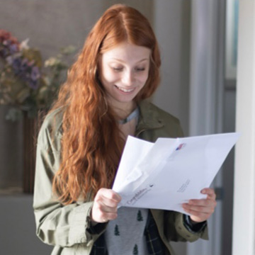 smiling woman holding papers