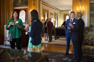 Guests conversing at the Governor's Mansion