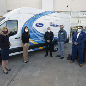 PCC staff standing with Ford reps in front of Ford van
